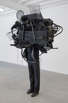"Daniel FIRMAN, ""Black hole"", 2009, Plaster, clothes and objects"