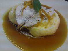 Crêpes soufflées à l'orange, zestes confits et sauce suzette.