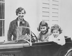 Devoted: Crawfie is pictured above with Elizabeth and Margaret in a miniature car.The trial month became 17 years and the bond between 'Crawfie', as the princess dubbed her teacher, and 'Lilibet', as the governess called her pupil, came to redefine royal history