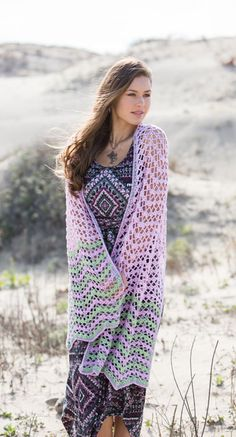 The perennial fave crochet chevron pattern is elevated with a fancy shell-stitch variation to breathe new life into ripples with the Dawn Waves Shawl. Fun and addictive to work, this crochet shawl can be expanded into an afghan or downsized for a scarf.