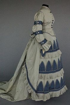 A fine two-tone blue silk faille visiting gown, circa 1870, more side detail