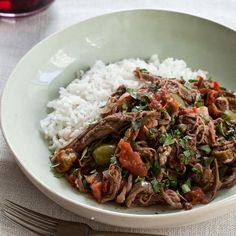 Slow Cooker Ropa Vieja   This Cuban stew, featuring shredded flank steak, tomatoes and olives, can be made up to two days in advance.