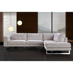This sectional sofa adds an elegant touch to anyone who has a living room with limited space. With a unique fabric that changes tone under certain angles and light, and razor thin support legs, true modern beauty is all that can be said about this sectional.