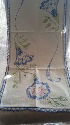 This runner is near perfect. It is made from heavy linen and the vibrant blues, greens and pinks There is one small spot on the lace on the rounded corner that is a wee frayed. There is no stains or yellowing. A wonderful piece. The measurements are 37 x Vintage Embroidery, Embroidery Stitches, Hand Embroidery, Embroidery Designs, Baby Bracelet, Embroidered Flowers, Table Runners, Baby Books, Needlework