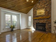 Floor to ceiling brick fireplace. Brick Fireplaces, Realtor Websites, Mantle, Living Rooms, Modern Design, Real Estate, Ceiling, Flooring, Interior