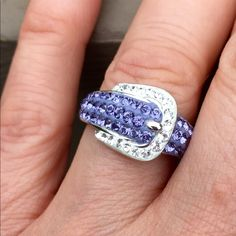 NWT Sterling Silver Swavorski Ring This buckle style ring is so gorgeous💓. Size 7 Sterling Silver with purple and white Swavorski Crystal elements by Kaleidoscope. Brand new with retail tag attached to ring price $230.  💓PRICE FIRM 💓 . ‼️PRICE FIRM‼️SELLING BELOW COST‼️ Swarovski Jewelry Rings
