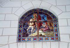 Eglise Saint-Martin à Bournan (37240) - Le vitrail de la charité de saint Martin (date de 1874, par Guérithault, fait à Poitiers).