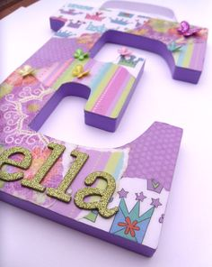 For Layla's small wall her bed is on. Make her whole name in big wooden letters. Decoupage wooden letter using multiple pieces of paper.