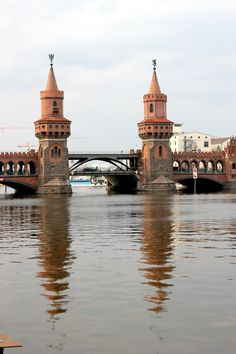 Oberbaumbrücke  The Oberbaum Bridge is a double-deck bridge crossing Berlin's River Spree, considered one of the city landmarks. It links Friedrichshain and Kreuzberg, former boroughs that were divided by the Berlin Wall, and has become an important symbol of Berlin's unity.