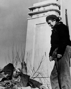 Madrid, Spain. A member of the International Brigades with a Spanish Republican soldier. By Robert Capa, (November-December 1936)