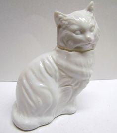 Vintage Avon Cat Decanter / Bottle Figurine, It Is EMPTY by VINTAGEandMOREshop on Etsy https://www.etsy.com/listing/229920409/vintage-avon-cat-decanter-bottle