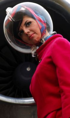 Braniff Airlines uniform, mid 60's Pucci design - her expression, and can't say I blame her :))