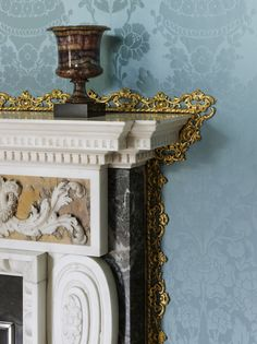 Detail of the State Apartments at Kedleston, with a blue-john urn and a gilded fillet surrounding the fireplace.
