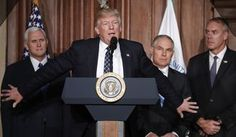 President Donald Trump, accompanied by from left, Vice President Mike Pence, Environmental Protection Agency (EPA) Administrator Scott Pruitt, and Interior Secretary Ryan Zinke, speaks at EPA headquarters in Washington, Tuesday, March 28, 2017, prior to signing an Energy Independence Executive Order. Trump signed an executive order aimed at moving forward on his campaign pledge to unravel former President Barack Obama's plan to curb global warming. (AP Photo/Pablo Martinez Monsivais)