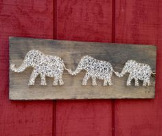 These cream colored elephants are hand strung with cream and gold string on 7 by 19 inch aged wooden boards. Due to the nature of the wood, each piece is unique and may vary from what you see in the picture but we feel that this makes each order a real one of a kind. These