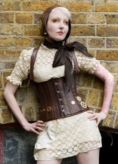 Made to measure - Leather corset with machined brass cogs - High end steam punk fashion. £255.00, via Etsy.