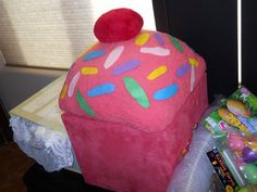 Giant cupcake made with a ottoman and fabric..inside was filled with stuff to make cupcakes ..great gift for any little girl