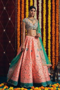 IN-0105-02: Make it pop like a pink champagne...Our champagne pink and green bridal lehenga to pop up the celebrations on your big day.They can customize the dress as per your requirement. For more detail 03 February 2018