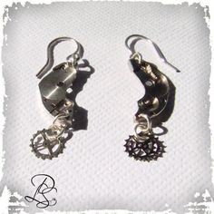 """made from real watch parts you'll love these dangle earnings with little gears on the end, earrings are 1"""" long,sterling silver ear wire"""