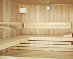 sauna interior made in hemlock wood cladding. 2 tier benches with back and headrests