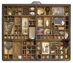 Old drawers holding antiques items