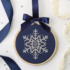 Stitch a pretty snowflake ornament that glitters with silver beads. Finish it in. - Stitch a pretty snowflake ornament that glitters with silver beads. Finish it in a hoop with a - Cross Stitch Christmas Ornaments, Xmas Cross Stitch, Cross Stitch Love, Beaded Cross Stitch, Christmas Embroidery, Cross Stitch Designs, Cross Stitching, Cross Stitch Embroidery, Christmas Cross Stitch Patterns