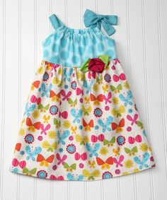This looks like you start with a pillowcase dress and just add cute fabric to it. Again, time to learn how to do this with THREE girls, right?!