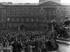 Members of the crowd outside Buckingham Palace crane their necks to view the royal family who have appeared on the balcony to wave after the wedding of Princess Elizabeth (Queen Elizabeth II) to Prince Philip, Duke of Edinburgh at Westminster Abbey on 20 November 1947.
