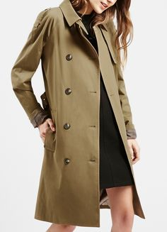 This classic, double-breasted trench in a gracefully long silhouette is sure to remain in style for seasons to come.
