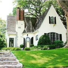 Black and white cottage style house Cozy Cottage, Cottage Homes, White Cottage, Tudor Cottage, Modern Cottage, White Farmhouse, Casas Tudor, Storybook Homes, Storybook Cottage