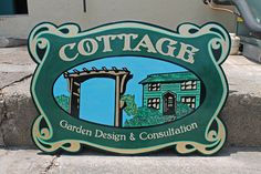 Cottage Garden sign hand painted from hand sketched design with gold leaf... these guys design your garden in style.