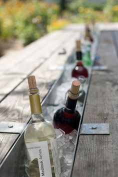 Love this idea! For those of you who love alfresco dining as much as I do. Remove the middle plank of a picnic table, insert with a trough, and fill with ice to keep wine bottles chilled.