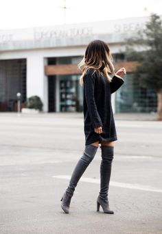 Pam Hetlinger has created a super cute fall style in a knitted sweater dress and a pair of thigh high suede boots.