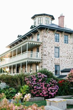The reception took place by the ocean, at Stone House, in Little Compton, Rhode Island.Catering and Cake: Russell Morin Fine Catering. Lighting: Jack Falvey Inc.
