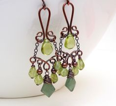 Copper dangle earrings Peridot earrings Copper earrings Peridot and Green garnet earrings. $75.00, via Etsy.