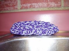 knifty knitter dish scrubber. Makes me wish I had kept the long looms. Maybe I can make this on the round?