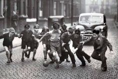 In pictures: Everton now and then - Children play football in a street in Everton 21 January 1956