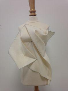 Draped with a triangular piece of muslin. It can create a nice, organic look.