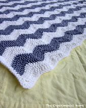 Ravelry: Chevron Crochet Baby Blanket pattern by Laura Kovacs  @Winter Tripp  - sent you a FB message about this one. Free pattern and I could use whatever colors you like.
