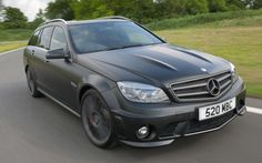 """MB C63 AMG DR 520 Wagon in Matte Black, with a personalized plate that says """"BATMOM."""" Oh yes."""