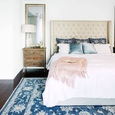 This bedroom proves the power of bright and patterned accessories. #homedecor  (Photo by Mike Garten, design by @susana.chango)