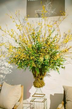 forsythia and moss arrangement by gathering floral event design charleston weddings magazines 2013 spring - Forsythia Arrangements