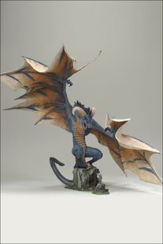 This might be a cool dragon, for the top of a Fantasy Football Trophy.....