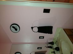 Girls bathroom idea to use black light switch and outlet covers