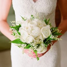 Eight pretty bridal bouquets chock full of ranunculus blossoms.
