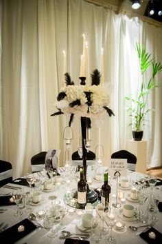 Romantically-lit voiles create the ideal backdrop to candelabras decorated with flowers and feathers...simply elegant.