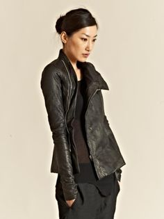 Snake leather jacket, don't like the idea, but is looks awesome on this girl. Rick owen