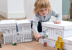 Repurpose your shoe boxes. Cover with paper and draw in building details. Then stack and arrange them to create a city.