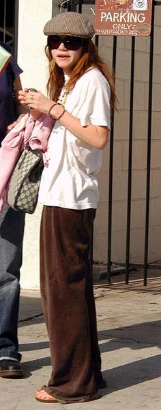 Mary-Kate Olsen wearing Juicy Couture Terry Pants in Grant, Gucci Stripe Satchel, Andy Warhol Banana Tee in White,  Mary-Kate Out to Lunch Nove...