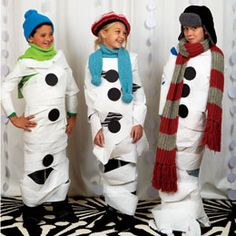 Project Snowman Game. Give teams of kids toilet paper and winter accessories to have a indoor snaowman building contest. winter accessories, snowman party, winter parties, christmas parties, party games, kid, toilet paper, birthday ideas, winter birthday